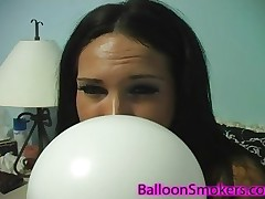 Kitty Bella loves to blow a balloon till it pops