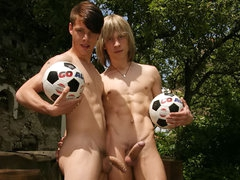 Two young soccer player engulf and fuck on the green grass!