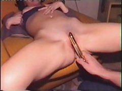 Golden sex-toy in the cunt