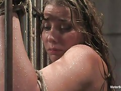 brunette chained and submersed in water
