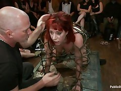 redhead milf in a cage abused and fucked