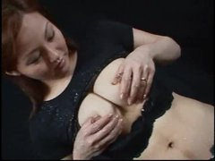 Asian playgirl with lactating tits squeezes and squirts